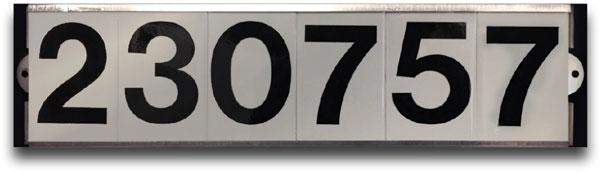 white reflective sign with six black numbers